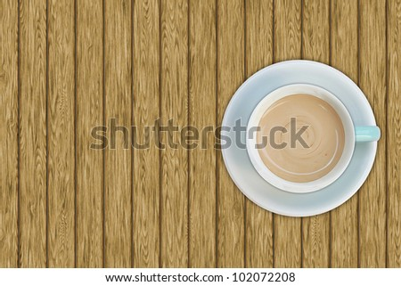 Top view of coffee cup on the wooden table