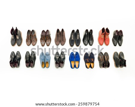 top view of collection of male shoes isolated on white background - stock photo