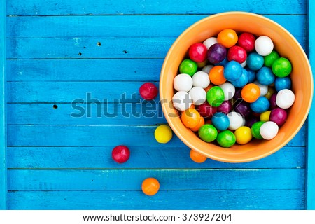Top view of colorful candy on blue table