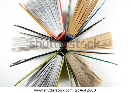 Top view of colorful hardback books in a circle. Back to school. - stock photo