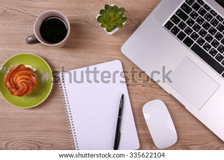 Top view of comfortable working place on wooden background - stock photo