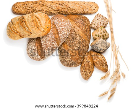 Top view of composition with bread, rolls and wheat ears isolated on white background. - stock photo