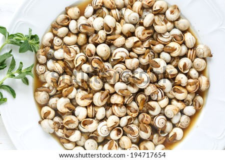 top view of cooked snails (escargot) - traditional portuguese snack - stock photo