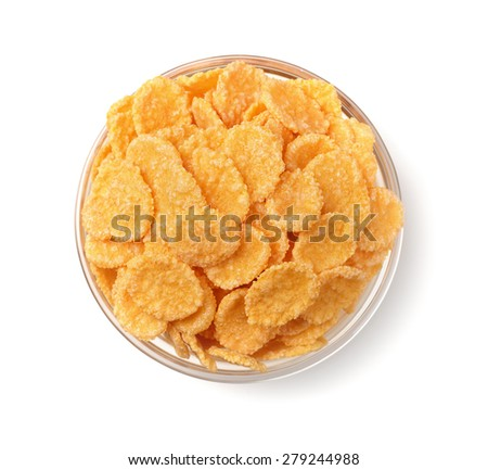 Top view of corn flakes in glass bowl isolated on white - stock photo