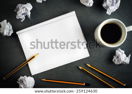 Top View of Creative Writing Concept With Pencils, Coffee Cup, Notepad and Crumpled Paper on Table. - stock photo