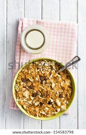 top view of crunchy muesli in bowl - stock photo