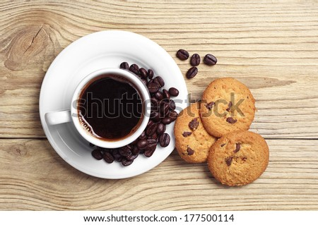 Top view of cup of coffee and plate of chocolate cookies - stock photo