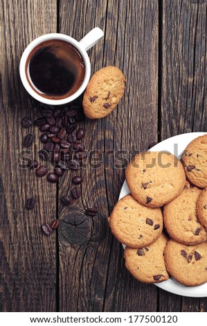 Top view of cup of coffee and tasty chocolate cookies - stock photo
