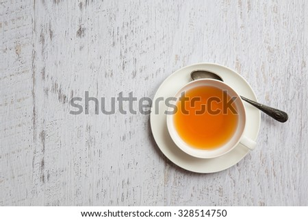 Top view of cup of tea on white vintage background - stock photo