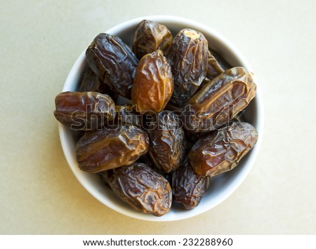 Top view of dates on white plate  - stock photo