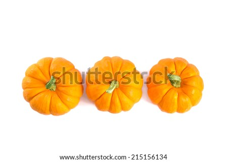Top view of decorative orange pumpkins, isolated on white background   - stock photo