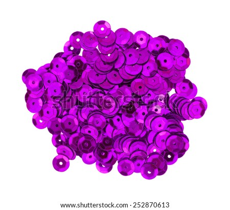 Top view of deep purple metallic sequins on a white background.