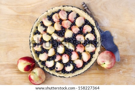 Top view of delicious tart filled with peaches and blueberries - stock photo