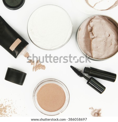 Top view of different cosmetics products on the white background