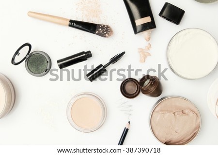 Top view of different cosmetics products on the white background - stock photo