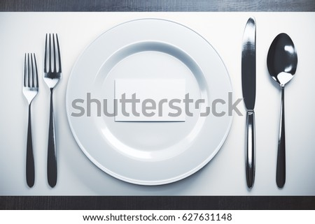 Top view of dinnerwear with empty white business card. Mock up, 3D Rendering