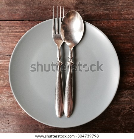 Top view of dish spoon and fork