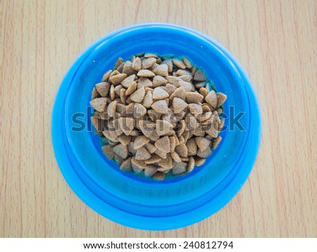 Top view of Dog food in color bowl - stock photo