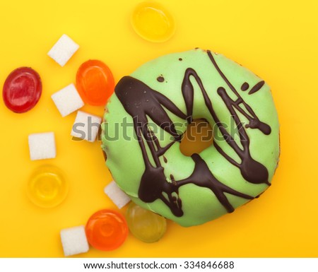top view of donut and colorful candies - stock photo