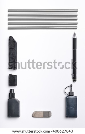Top view of drawing tools on white blank paper
