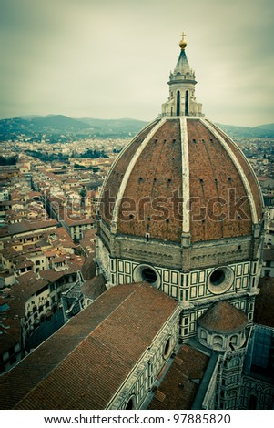 Top view of Duomo Cathedral Santa Maria del Fiore in Florence, Tuscany, Italy with cross processed vintage look - stock photo