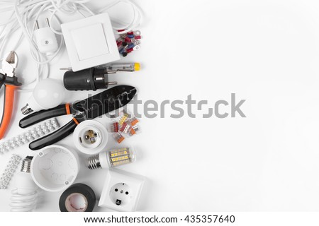 top view of electrical tools and equipment on white - stock photo