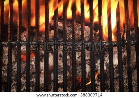 Top View Of Empty And Clean  Barbecue Charcoal Grill With Flames Of Fire, Close Up - stock photo