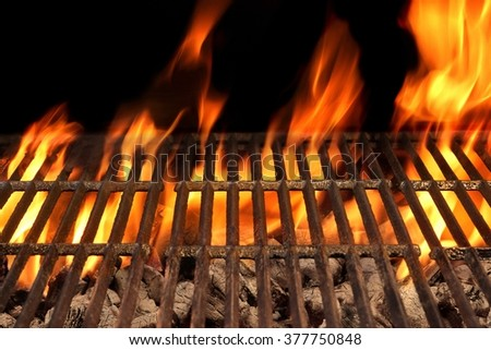 Top View Of Empty Barbecue Hot Fire Grill And Burning Charcoal Briquettes With Bright Flames. Outdoor Scene. Concept for Summer Party Or Picnic Or Cookout. Isolated Black Background. Close Up - stock photo