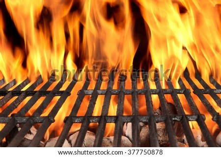 Top View Of Empty BBQ Hot Fire Grill And Burning Charcoal Briquettes With Bright Flames. Outdoor Scene. Concept for Summer Party Or Picnic Or Cookout. Close Up - stock photo