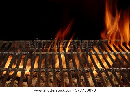 Top View Of Empty BBQ Hot Fire Grill And Burning Charcoal Briquettes With Bright Flames. Outdoor Scene. Concept for Summer Party Or Picnic Or Cookout. Isolated Black Background. Close Up - stock photo