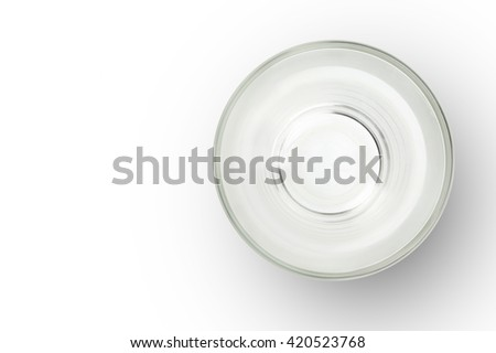 Top view of empty glass cup on white background. empty space for design. - stock photo