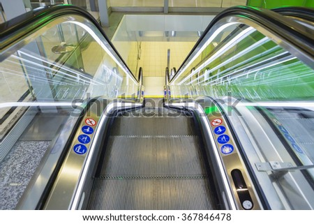 Top view of escalators, green color combination. panoramic angle of escalator detail. - stock photo