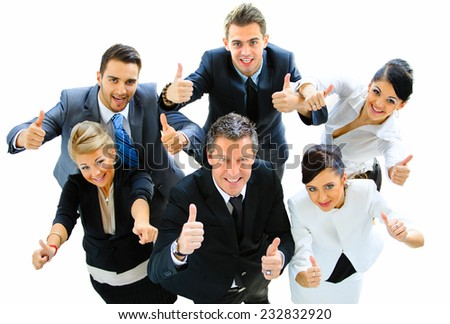 Top view of executives smiling and pointing - stock photo