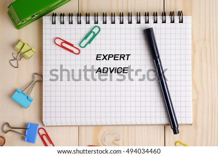 Top view of Expert advice on  notebook on wood table background concept. Decorated and blank space.