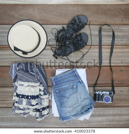 Top view of female essentials festival, vacation fashion items