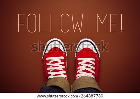 Top View of Follow Me Request Concept for Social Networking on Internet with Young Person in Red Sneakers from Above. - stock photo