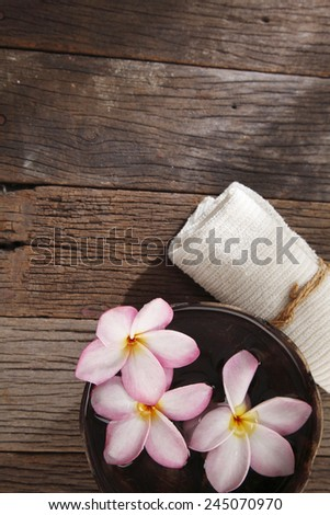 top view of frangipani flower ,hand towel and coconut shell - stock photo