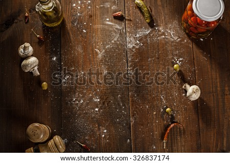 top view of fresh baked pizza served on wooden table - stock photo