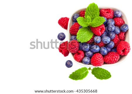 Top view of fresh berries over white isolated background