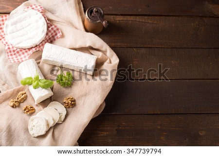 top view of fresh goat cheese in rustic style - stock photo