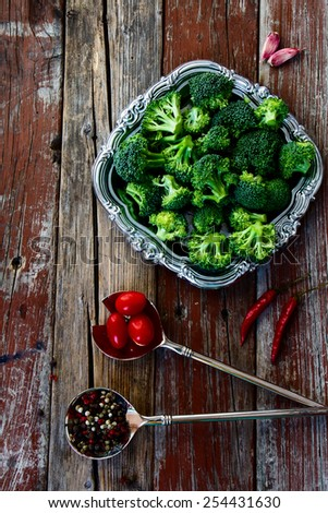 Top view of fresh green broccoli and Healthy Organic Vegetables on a Wooden Background.