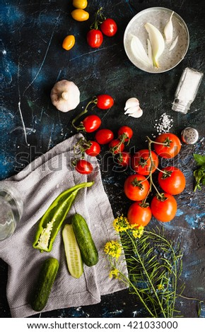 Top view of Fresh ingredients for gazpacho cold soup in a blender over dark marble table. Rustic dark style. Top view.  - stock photo