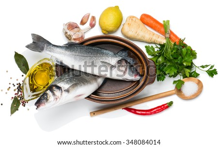 Top view of fresh raw fish and food ingredients isolated on white background - stock photo