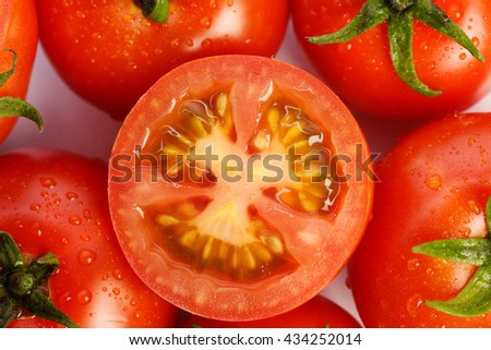 Top view of fresh tomatoes on white background - stock photo