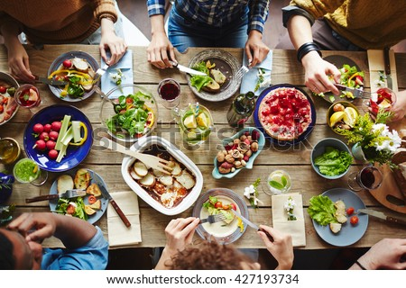 Top view of friends having lunch - stock photo