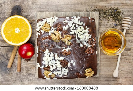 Top view of gingerbread cake with chocolate and hazelnuts - stock photo