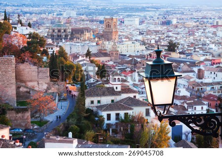 Top view of  Granada in evening from mount.  Spain. Focus on lantern - stock photo