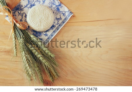 top view of greek cheese , bulgarian cheese on wooden table over wooden textured background. Symbols of jewish holiday - Shavuot  - stock photo
