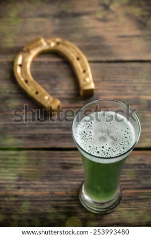 Top view of green beer for St. Patrick's day - stock photo