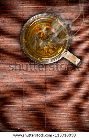 Top view of green tea on bamboo table - stock photo